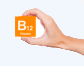An image showing a hand holding vitamin B12 template