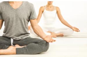 An image of people doing yoga